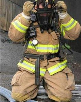 Firefighter Putting on Mask
